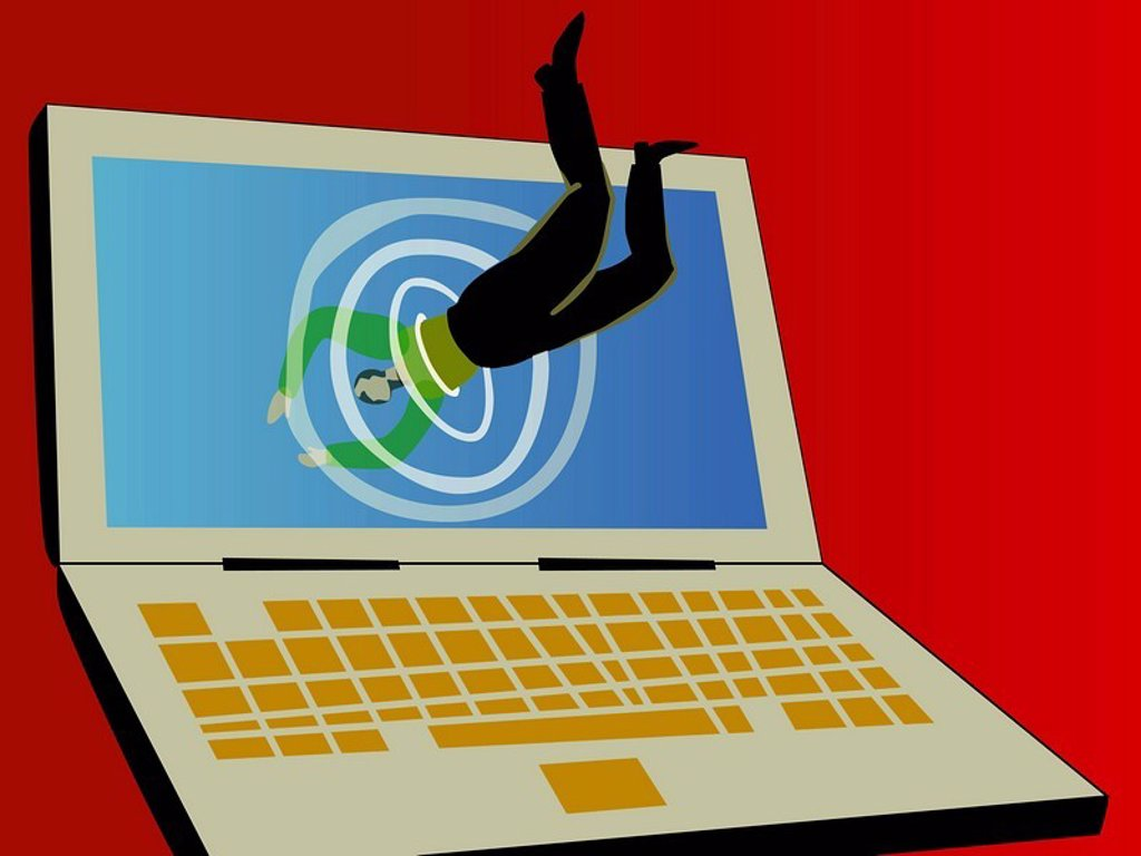 A businessman diving into the screen of a laptop : Stock Photo