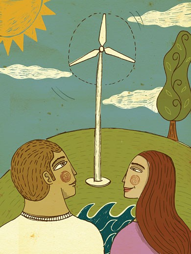 Two people looking at a wind turbine on a sunny day : Stock Photo