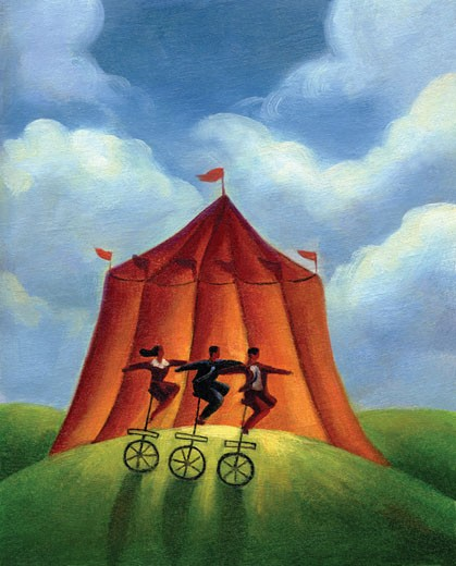 Three people on unicycles infront of a circus tent : Stock Photo
