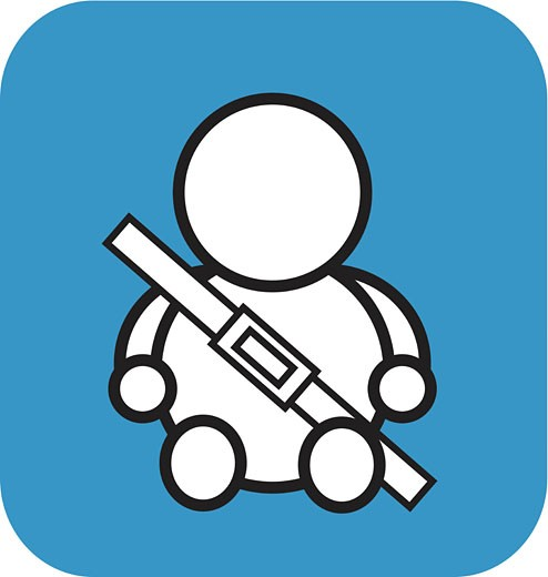 Stock Photo: 1538R-53817 A baby with a seat belt on a blue background