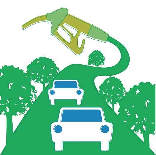 Cars driving on a green road attached to a gas pump : Stock Photo