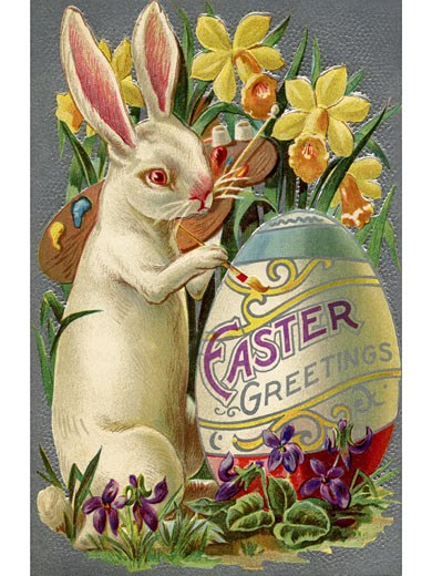A vintage Easter postcard of a rabbit painting an egg : Stock Photo