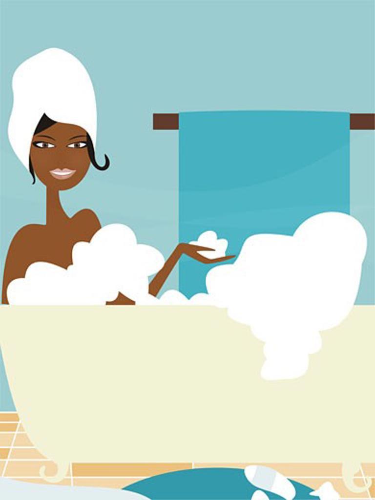 A woman taking a bubble bath : Stock Photo