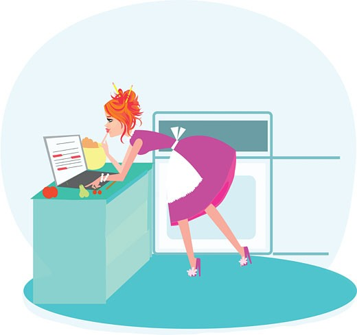 Stock Photo: 1538R-59999 A woman typing on her laptop while cooking