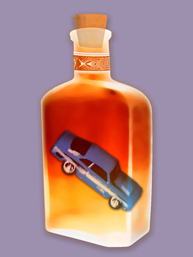 Crashing car inside bottle of alcohol : Stock Photo