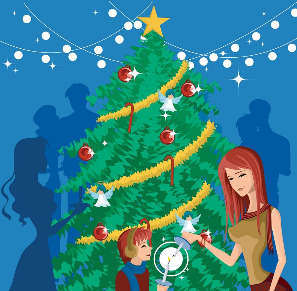 A mother and child lighting candles in front of a decorated Christmas tree : Stock Photo