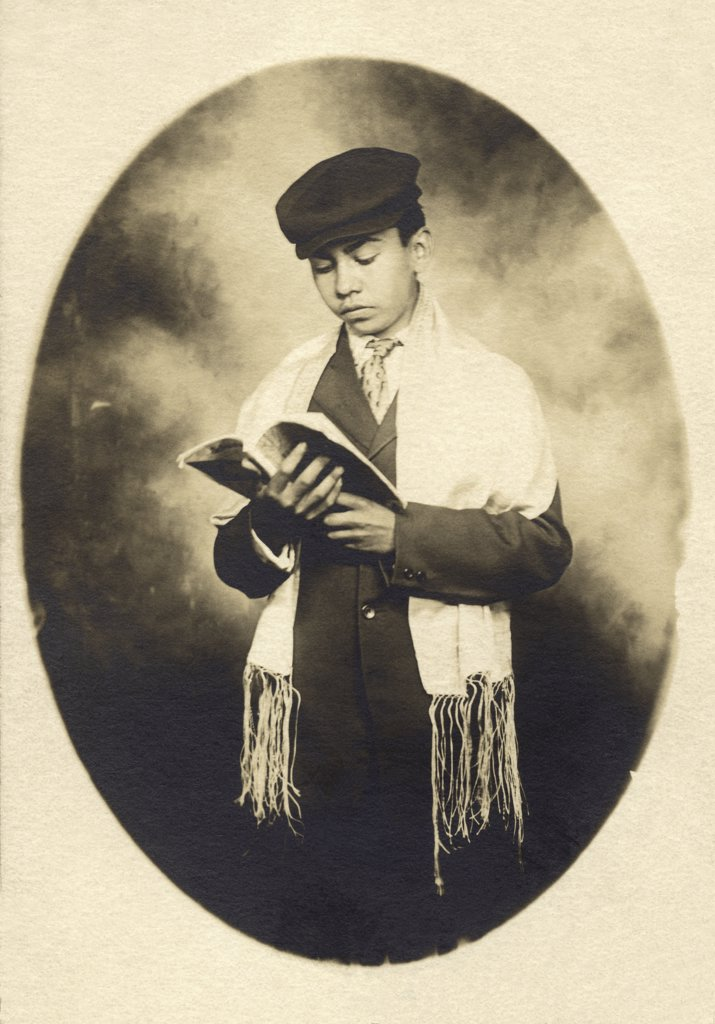 Close-up of a bar mitzvah reading a torah, c. 1915 : Stock Photo