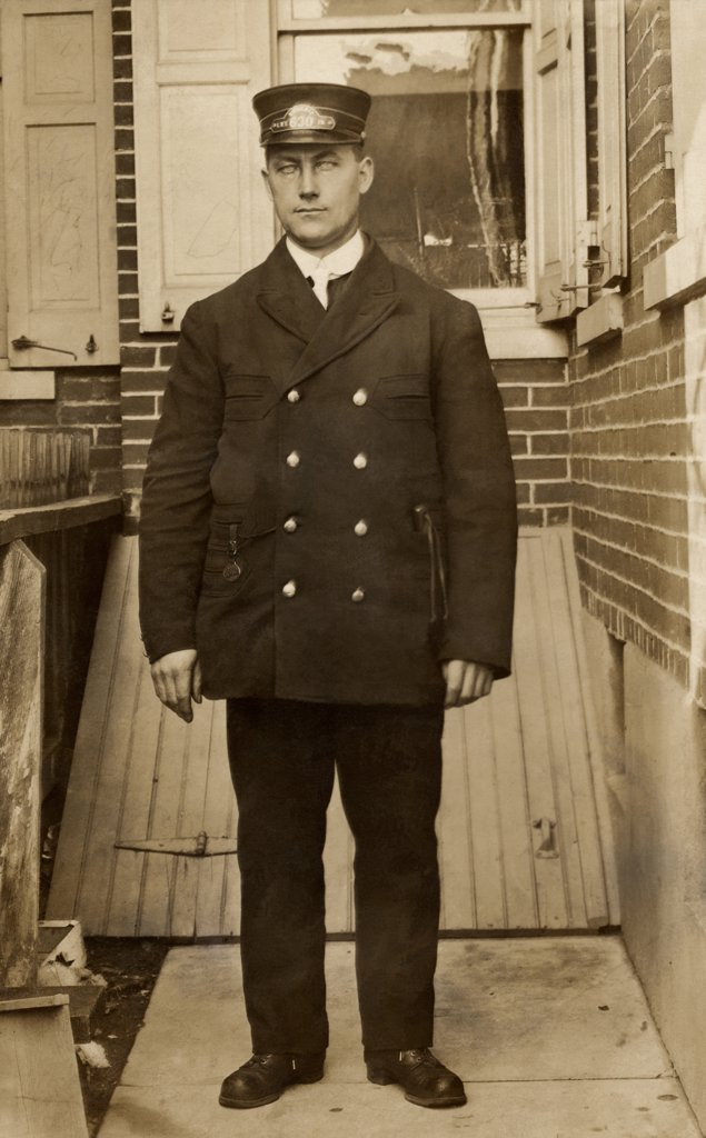 Young policeman standing, 1908 : Stock Photo