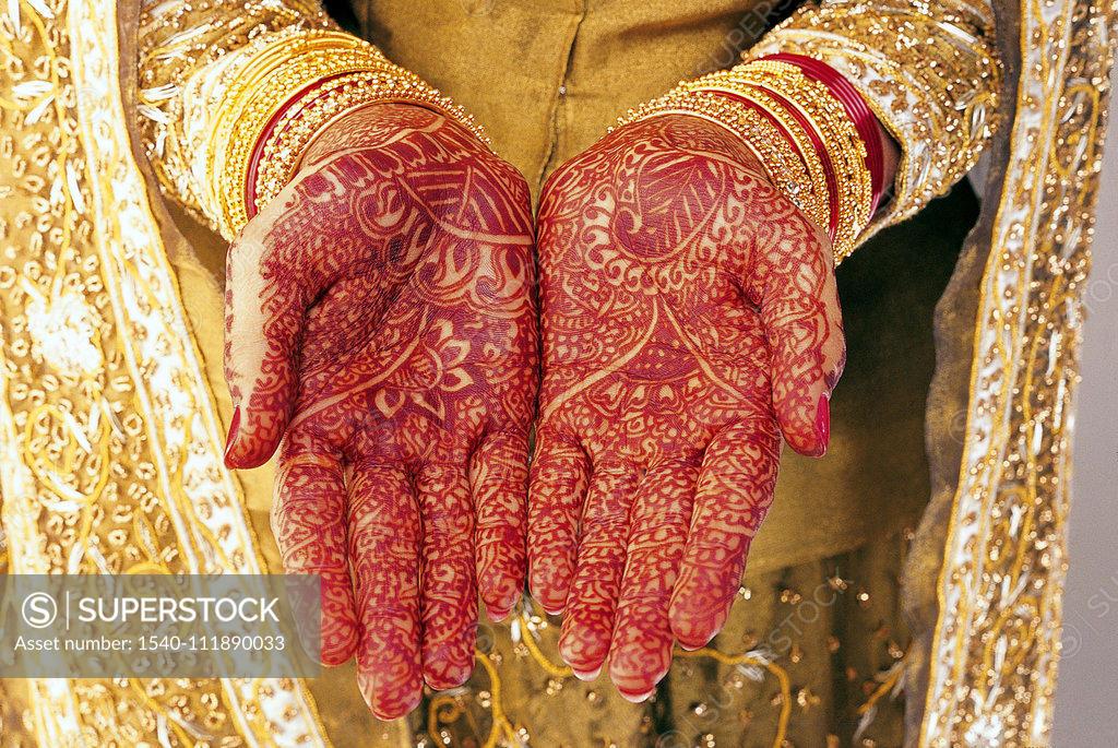 Stock Photo: 1540-111890033 Mehandi on Bride hands