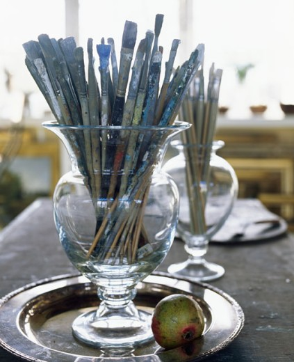 Stock Photo: 1545-335 Close-up of paintbrushes in jars on a tray