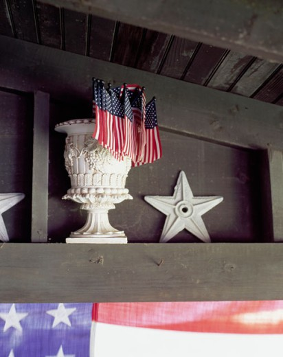 Close-up of flags in a decorative urn with a star beside it : Stock Photo