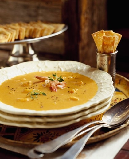 Close-up of soup in a bowl on a table with crackers : Stock Photo