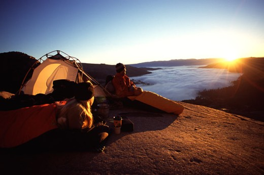Stock Photo: 1546-316 Father sitting with his daughter in front of a dome tent, Donner Summit, California, USA