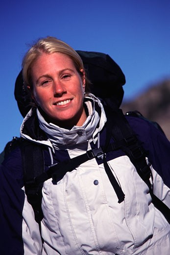 Stock Photo: 1546-503 Portrait of a female hiker smiling, Californian Sierra Nevada, California, USA