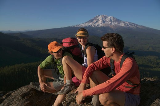 Stock Photo: 1546-905 Three hikers on a mountain summit, Mt Adams, Washington State, USA