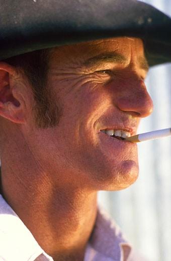 Close-up of a cowboy smoking : Stock Photo