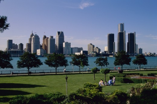Stock Photo: 155-1108A People at a park with buildings in the background, Detroit River, Renaissance Center, Detroit, Michigan, USA