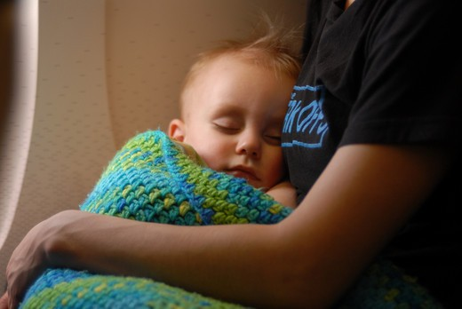 Stock Photo: 155-1596 Baby boy sleeping in his mother's arms