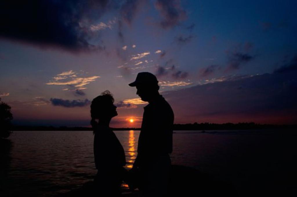 Stock Photo: 155-447B Silhouette of a couple on the beach, Tahiti, French Polynesia