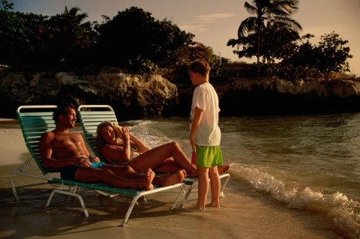 Stock Photo: 155-706B Mid adult couple on the beach with their son, Curacao, Netherlands Antilles