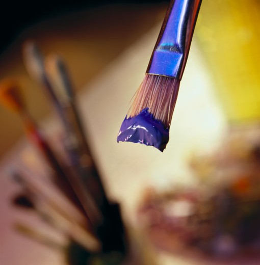 Brush with blue paint : Stock Photo
