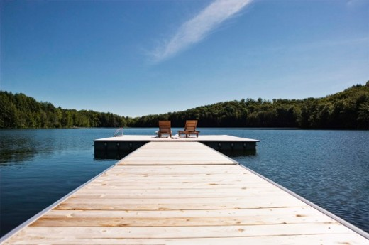 2 chairs on dock on lake. : Stock Photo