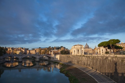 view of the river Tiber with Ponte Vittorio Emanuele 11 and St Peter's Bassilica : Stock Photo