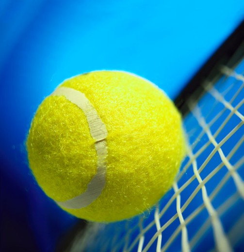 Tennis ball and racket : Stock Photo
