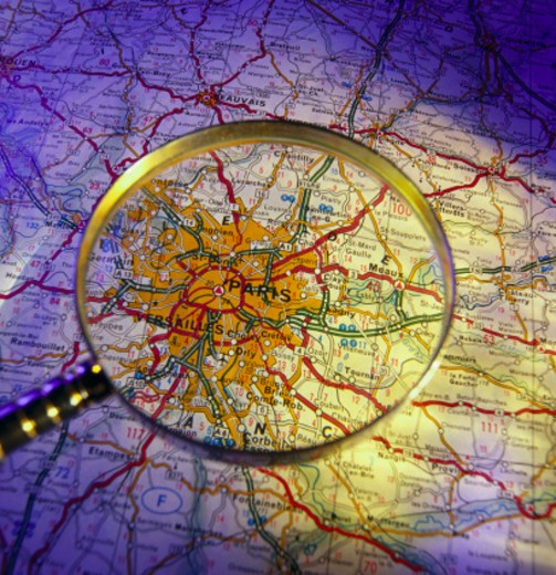 Stock Photo: 1555R-11031 Magnifying glass and map