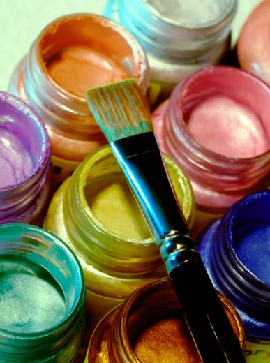 Pearlized paints and brush : Stock Photo