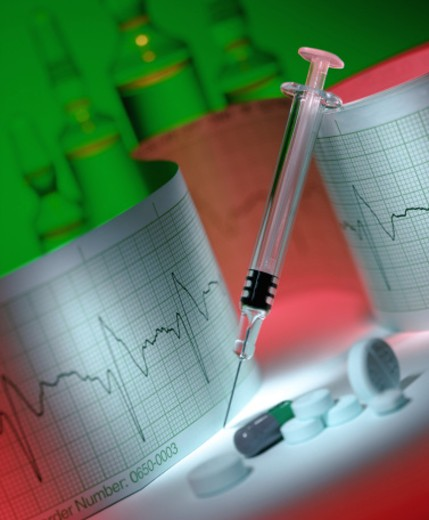 Syringe, pills and electrocardiogram : Stock Photo