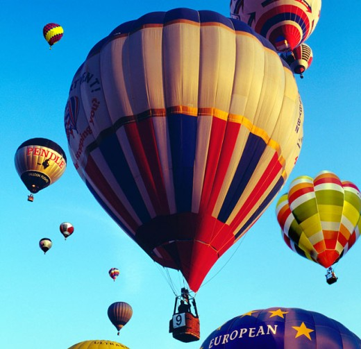 Floating hot air balloons : Stock Photo