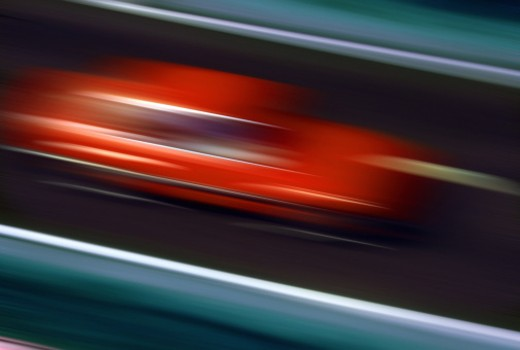 Speeding car on highway : Stock Photo