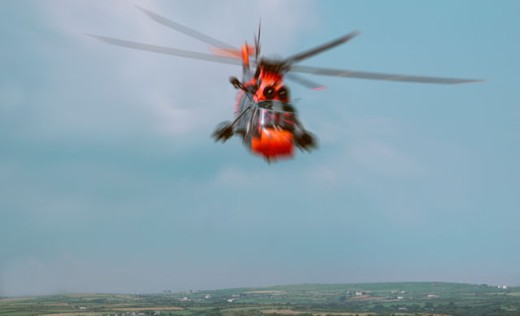 Stock Photo: 1555R-124076 Hovering helicopter
