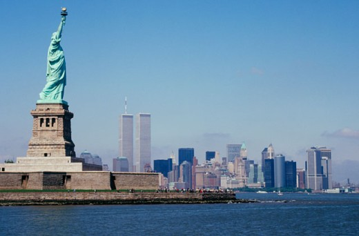 Statue of Liberty and New York skyline : Stock Photo