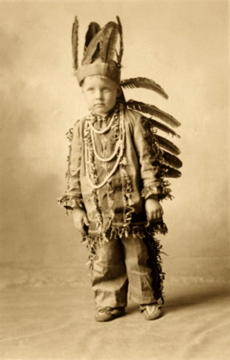 Boy in Native American costume : Stock Photo