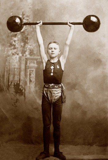 Stock Photo: 1555R-155100 Boy lifting weights