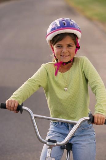 Girl on bike with helmet : Stock Photo