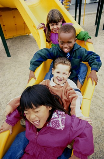 Kids on slide : Stock Photo