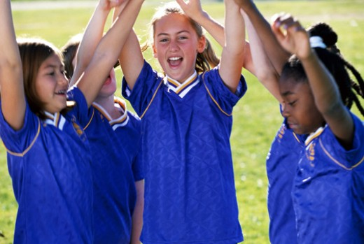 Soccer team cheering : Stock Photo