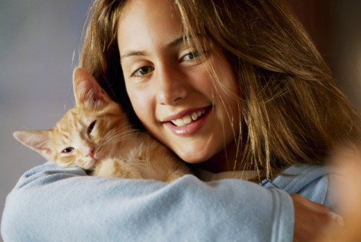 Stock Photo: 1555R-168070 Girl with a kitten