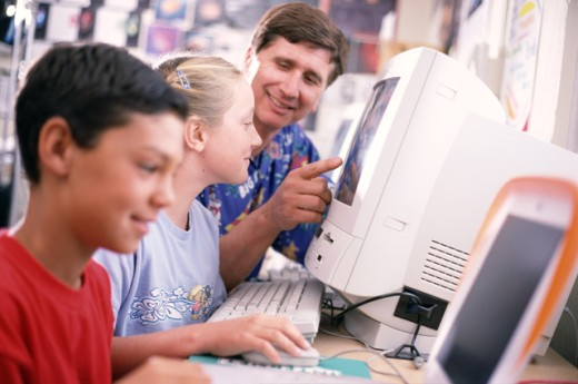 Students and teacher in computer class : Stock Photo