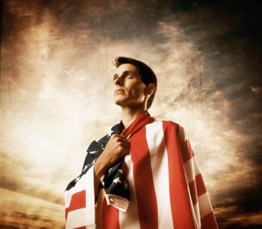 Man wrapped in American flag : Stock Photo