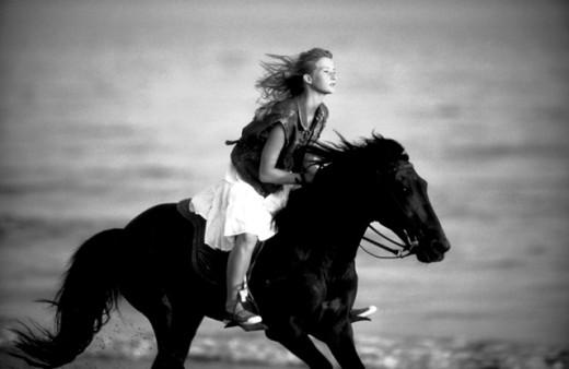 Stock Photo: 1555R-179062 Teenage girl horseback riding