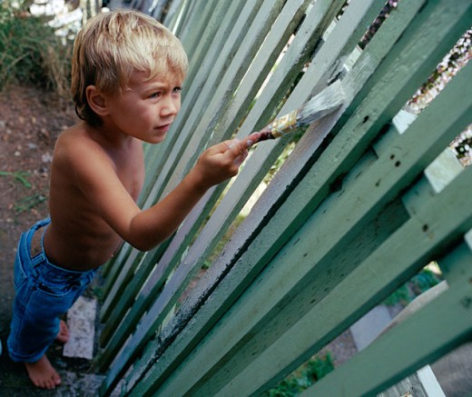 Stock Photo: 1555R-186067 Boy painting fence