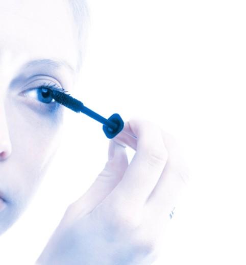 Woman applying mascara : Stock Photo
