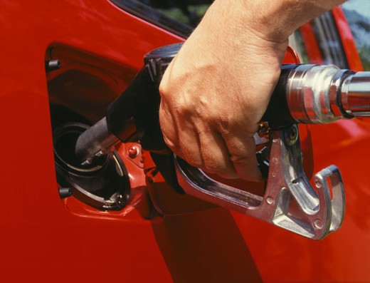 Stock Photo: 1555R-195007 Man pumping gas