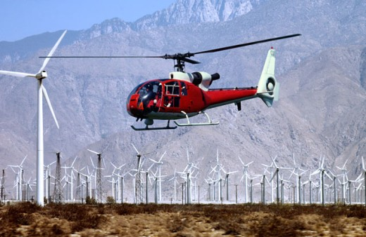 Helicopter and windmills : Stock Photo