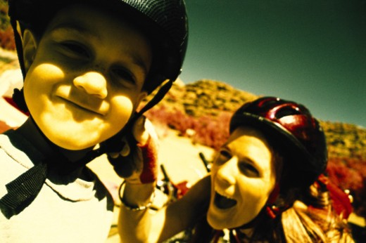 Woman and boy wearing helmets : Stock Photo