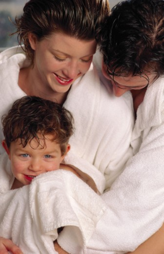 Parents drying off boy : Stock Photo